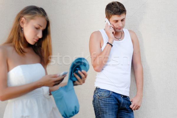 Férfi hív barátnő fiatalember nő női Stock fotó © rosipro