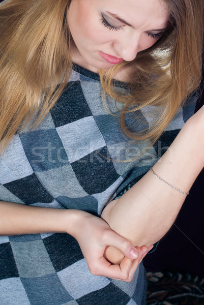 Fiatal nő érzés fájdalom könyök nő haj Stock fotó © rosipro