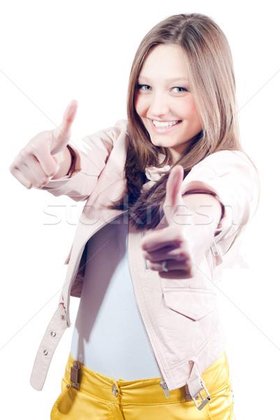 Gyönyörű boldog fiatal nő mutat hüvelykujj felfelé Stock fotó © rosipro