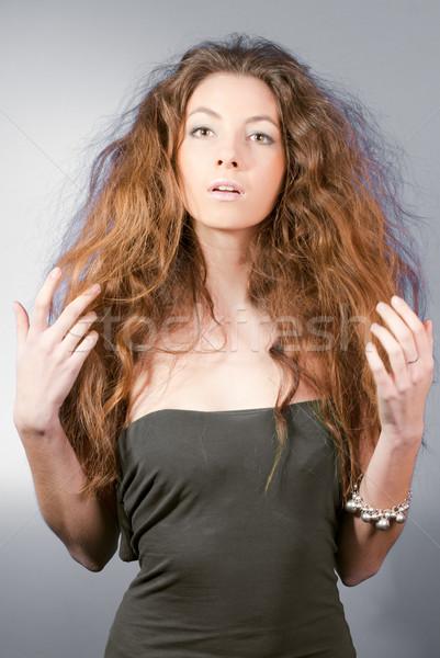 Gyönyörű fiatal nő kócos hajviselet néz furcsa Stock fotó © rosipro