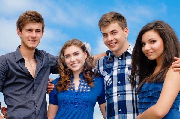 Boldog négy tini barátok ölel kék ég Stock fotó © rosipro
