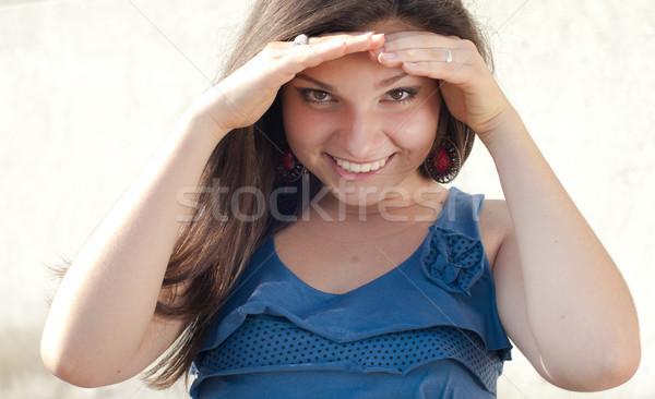 Boldog fiatal nő rejtőzködik szemek nap kezek Stock fotó © rosipro