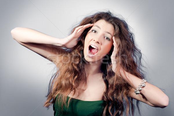 Gyönyörű fiatal nő kócos hajviselet sikít megrémült Stock fotó © rosipro