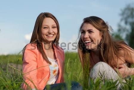 Dois feliz amigos grama verde mulher Foto stock © rosipro
