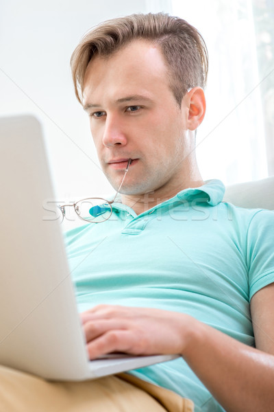 Man working with laptop Stock photo © RossHelen