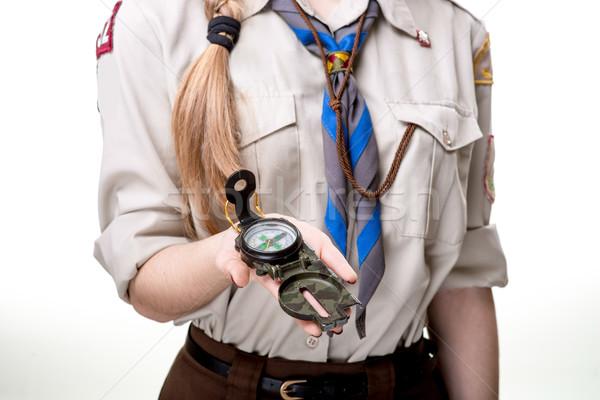 Verkenner studio meisje kompas geïsoleerd Stockfoto © RossHelen