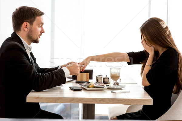 Man making proposal to his girlfriend at the restaurant Stock photo © RossHelen