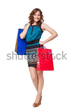 Stock photo: Portrait of young woman carrying shopping bags