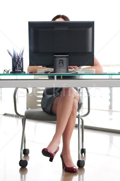 Kız oturma çalışmak yer arkasında bilgisayar ekranı Stok fotoğraf © rozbyshaka