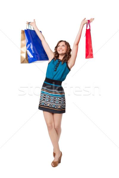 Portrait of young woman carrying shopping bags Stock photo © rozbyshaka