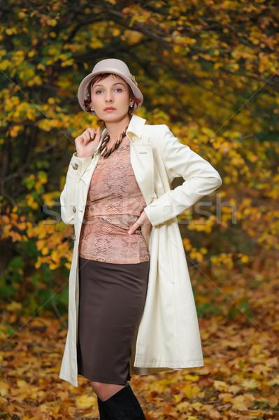 attractive woman in evening autumn park Stock photo © rozbyshaka