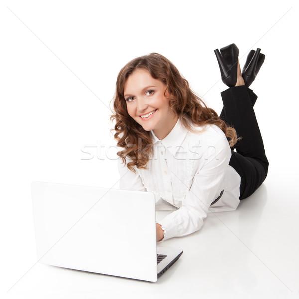 Woman with laptop lying down on the floor Stock photo © rozbyshaka