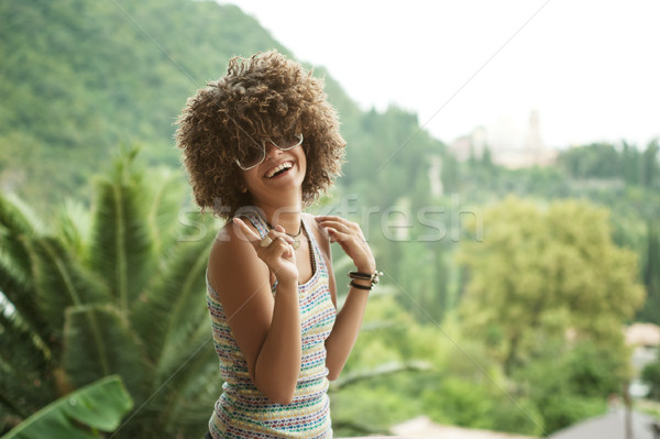 woman in a wig of curly hair Stock photo © rozbyshaka