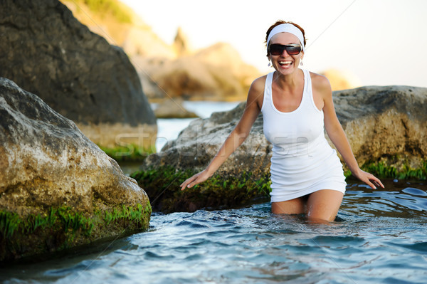 Beautiful woman splashing in the sea Stock photo © rozbyshaka