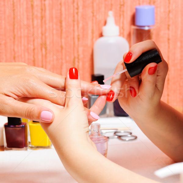Skin and nail care. Applying of the Transparent varnish.  Stock photo © rozbyshaka