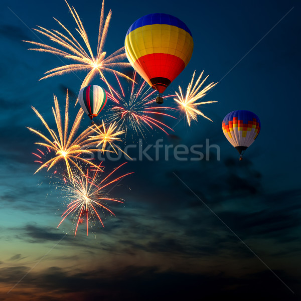 fireworks and hot air-balloon at sunset Stock photo © rozbyshaka