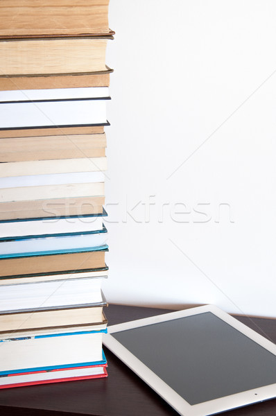 E-book reader and stack of books on a table Stock photo © rozbyshaka