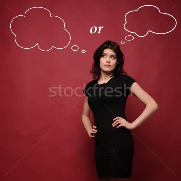çekici genç kadın düşünme stüdyo kırmızı kız Stok fotoğraf © rozbyshaka
