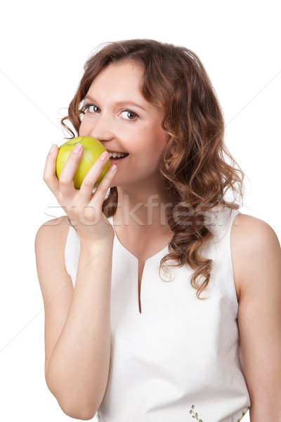 Portrait of fit young girl biting a fresh ripe apple  Stock photo © rozbyshaka