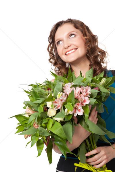 Stock photo: Portrait of pretty brunette holding bouquet of flowers