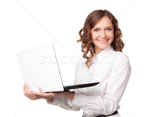 Portrait of a pretty young businesswoman holding a laptop Stock photo © rozbyshaka