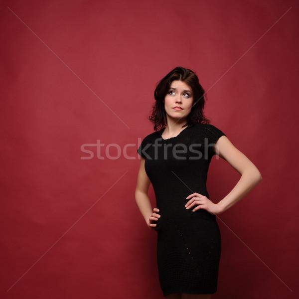 Attrattivo pensare studio rosso ragazza Foto d'archivio © rozbyshaka