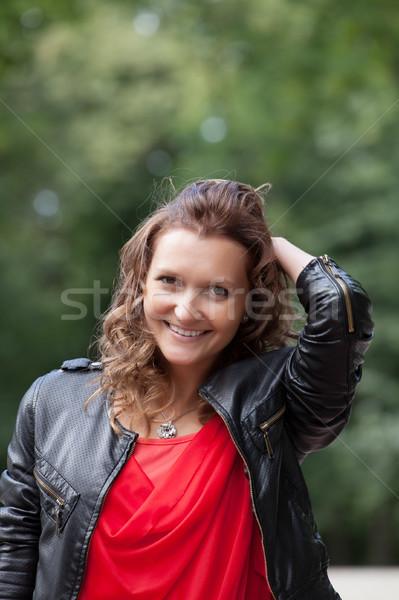 Portré fiatal mosolygó nő park áll nyár Stock fotó © rozbyshaka