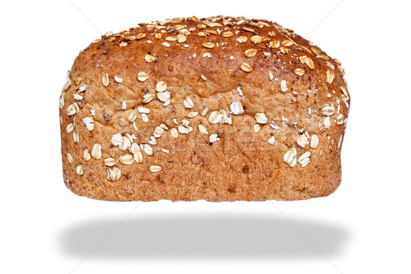 Loaf wholemeal bread isolated on awhite background. Stock photo © RTimages