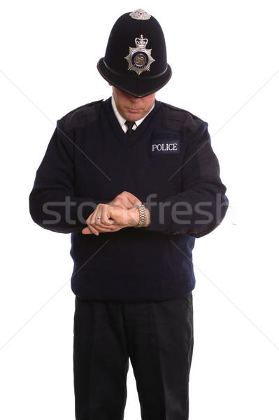 Policeman timecheck. Stock photo © RTimages
