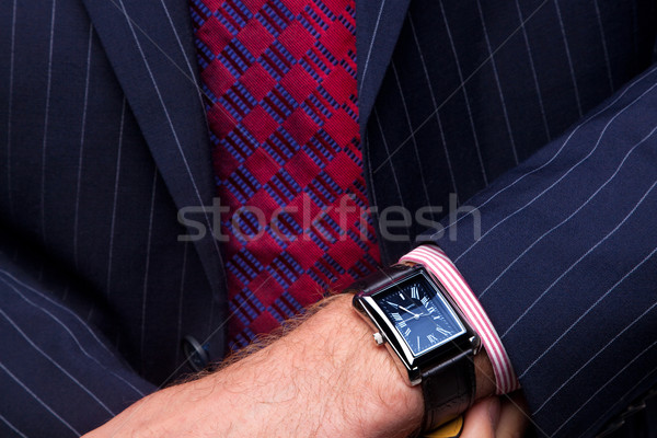 Businessman checking the time on his watch Stock photo © RTimages