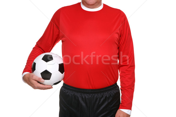 Football player holding ball isolated. Stock photo © RTimages