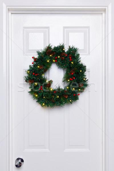 Chrismas wreath on a white door Stock photo © RTimages