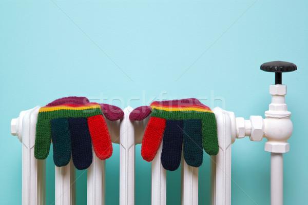 Stock photo: Striped woolen gloves on old radiator