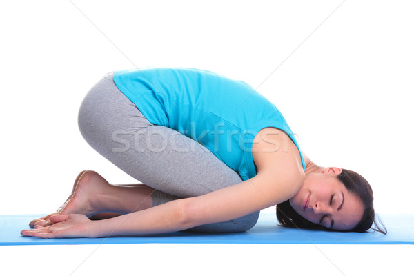 Woman doing yoga balasana - Childs pose Stock photo © RTimages