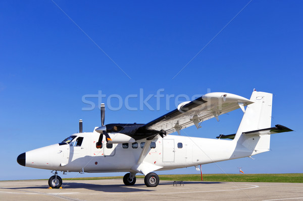 Twin propeller airplane on a runway. Stock photo © RTimages