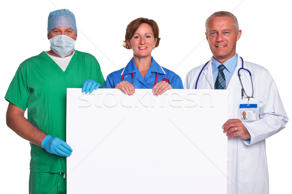 Medical team holding a blank poster isolated Stock photo © RTimages