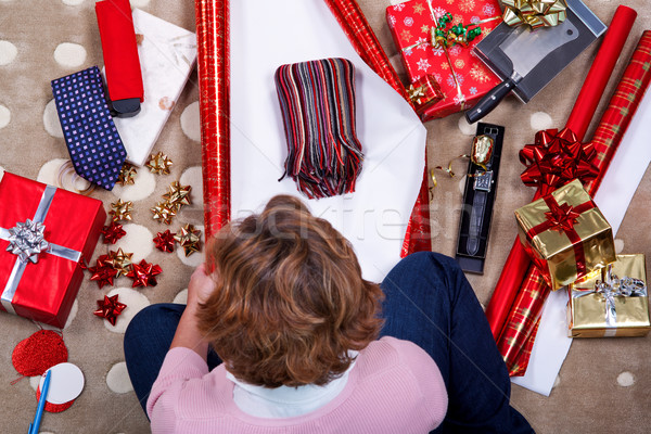 Overhead photo of a woman wrapping her Christmas presents. Stock photo © RTimages