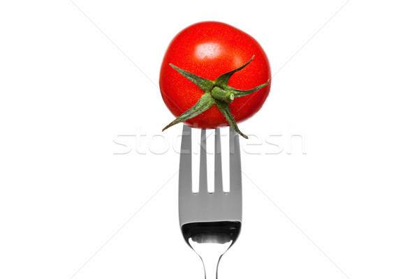 Tomato on a fork isolated on white Stock photo © RTimages