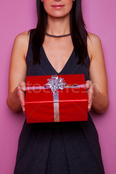 Woman holding a gift wrapped in red paper Stock photo © RTimages