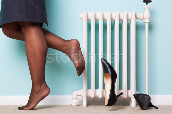 Woman kicking her heels off Stock photo © RTimages
