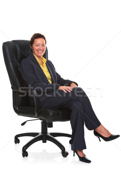 Mature businesswoman sat in leather chair isolated Stock photo © RTimages