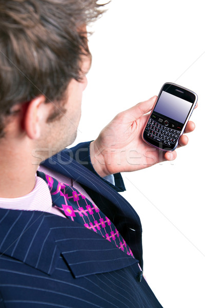 Businessman checking his phone for emails. Stock photo © RTimages