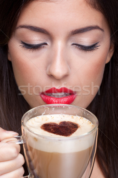 Woman drinking cappuccino coffee with love heart shape  Stock photo © RTimages
