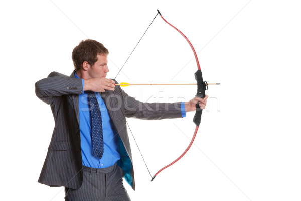 Businessman shooting a bow and arrow Stock photo © RTimages