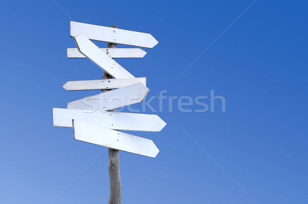 Eski ahşap tabelasını yıpranmış işaretleri mavi gökyüzü Stok fotoğraf © RTimages