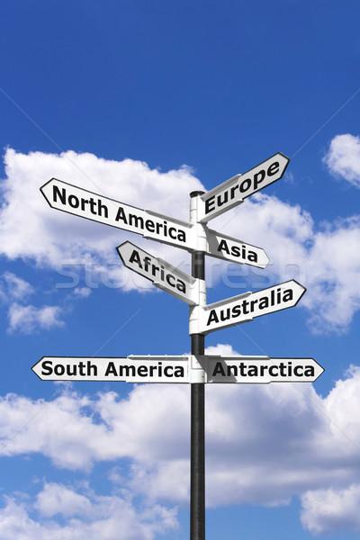 Hét kontinensek útjelző tábla függőleges nyilak mutat Stock fotó © RTimages