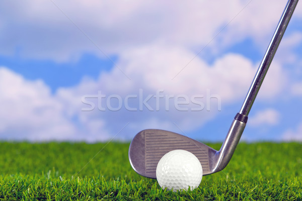 Golf iron behind ball Stock photo © RTimages