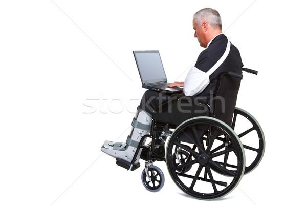 Zdjęcia stock: Ranny · biznesmen · laptop · wózek · odizolowany · Fotografia