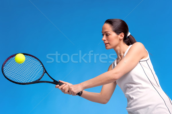 Femme jouer tennis avant-bras coup brunette Photo stock © RTimages