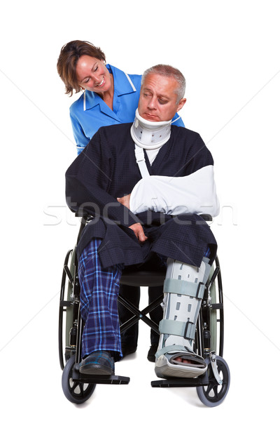 медсестры раненый человека коляске изолированный фото Сток-фото © RTimages